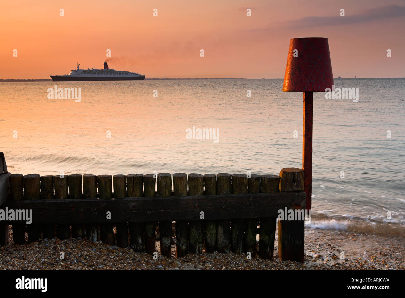The QE2 silently returning to her home port of Southampton at dawn - Stock Image