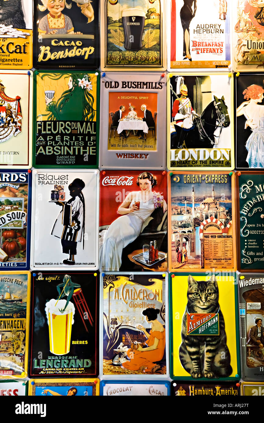 Reproductions of old advertising posters - Stock Image