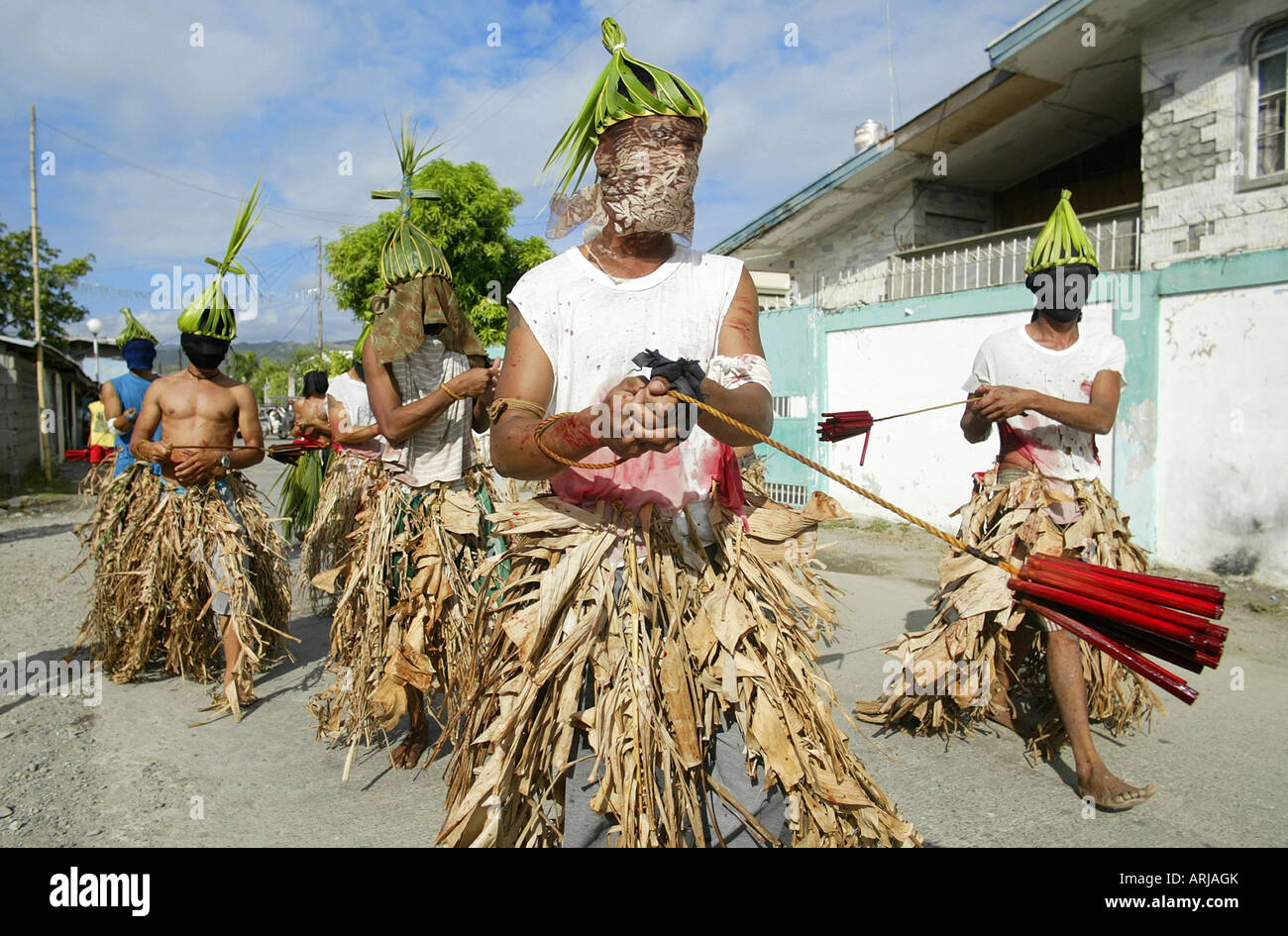 Penitent Filipinos flagellate themselves with bamboo whips on Good Friday in Mansalay, Oriental Mindoro, Philippines. Stock Photo