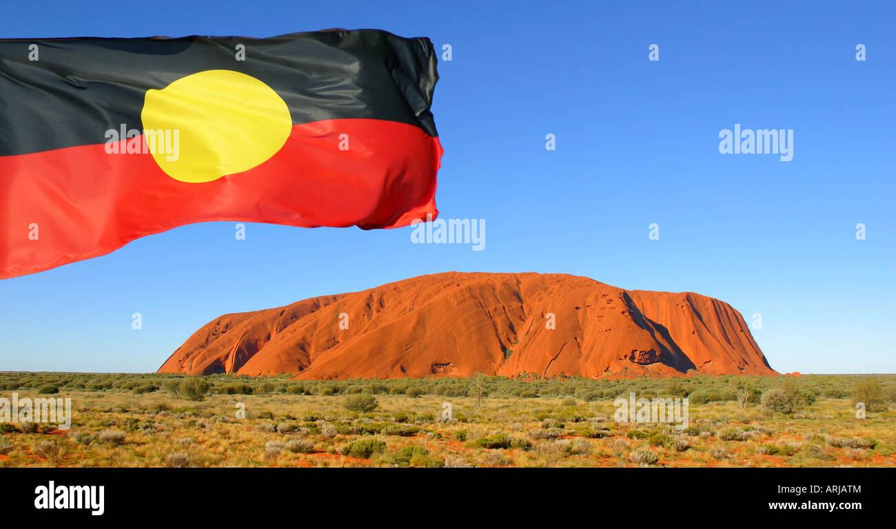 Aboriginal flag over Uluru Northern Territory Australia - Stock Image