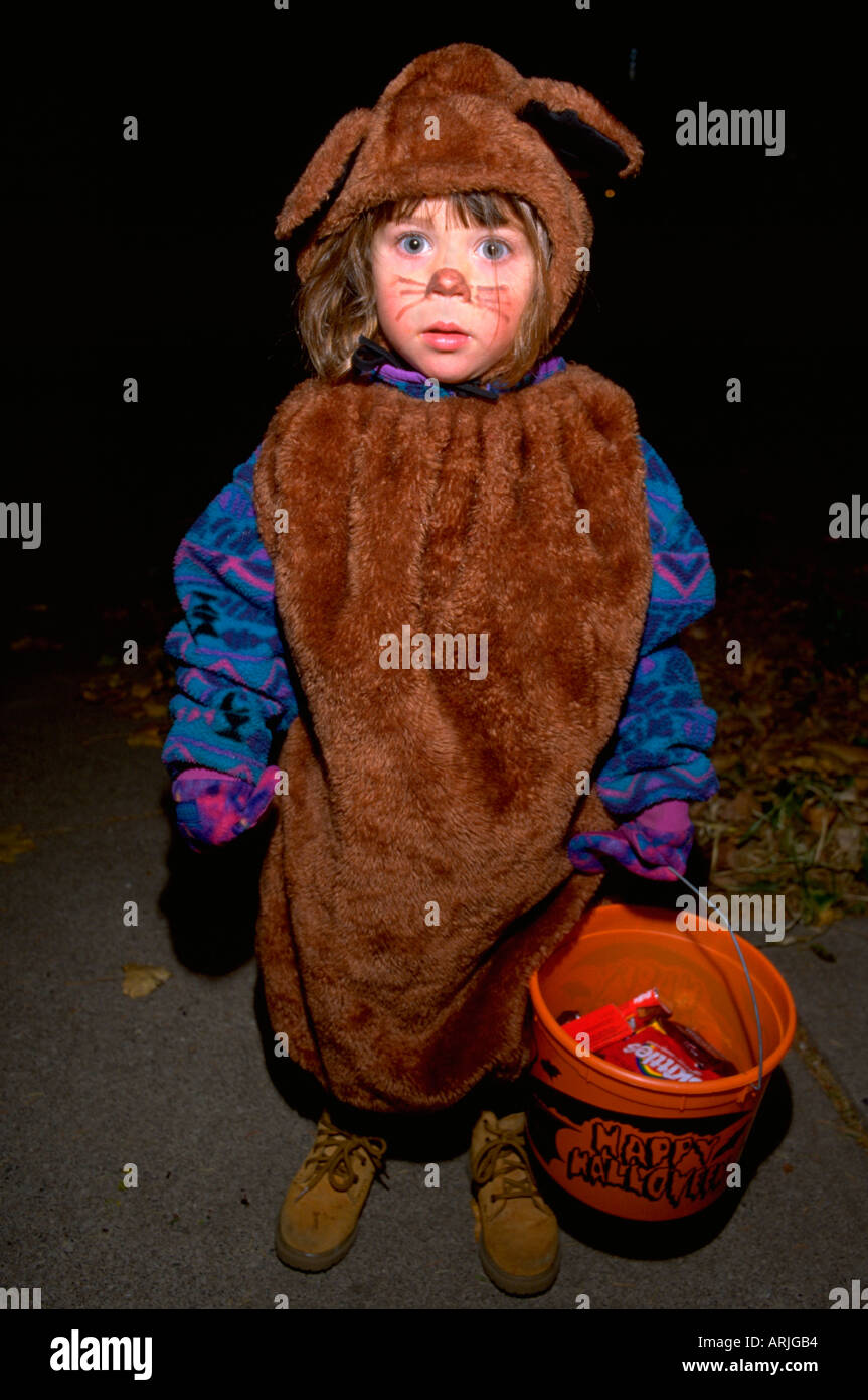 boy age 5 trick or treating dressed in bear costume for halloween