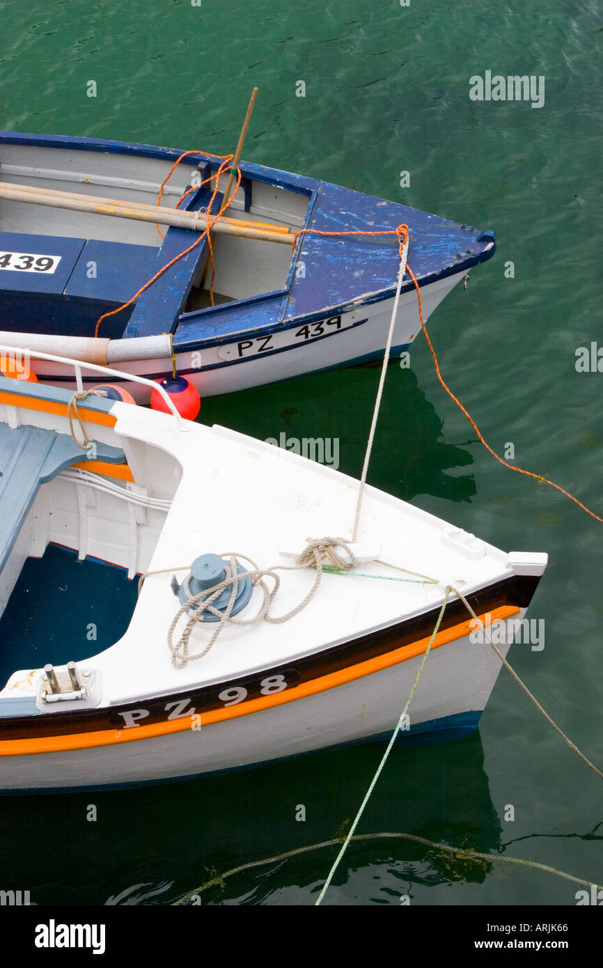 The front end of two moored fishing boats in Mousehole harbour Cornwall UK Stock Photo