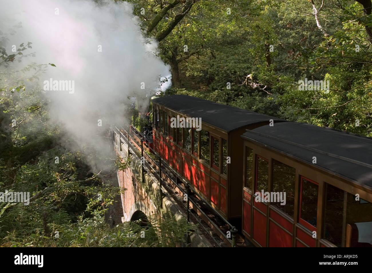 Talyllyn Railway - The Quarryman engine crossing bridge at Dolgoch Falls - Stock Image