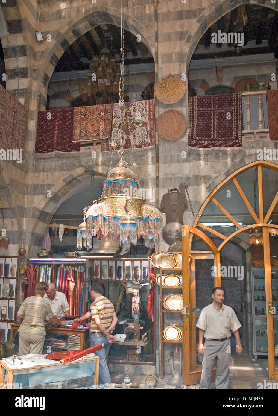 Interior of large shop, crowded market of al-Hamidiyya souk, souq, district of Damascus, Syria, Middle East. DSC Stock Photo