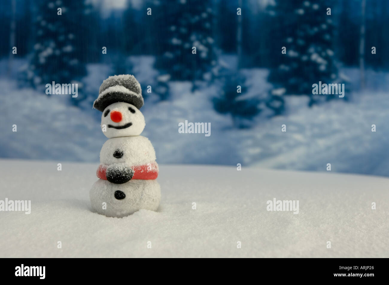 Model of a snowman with convincing fake snow - Stock Image