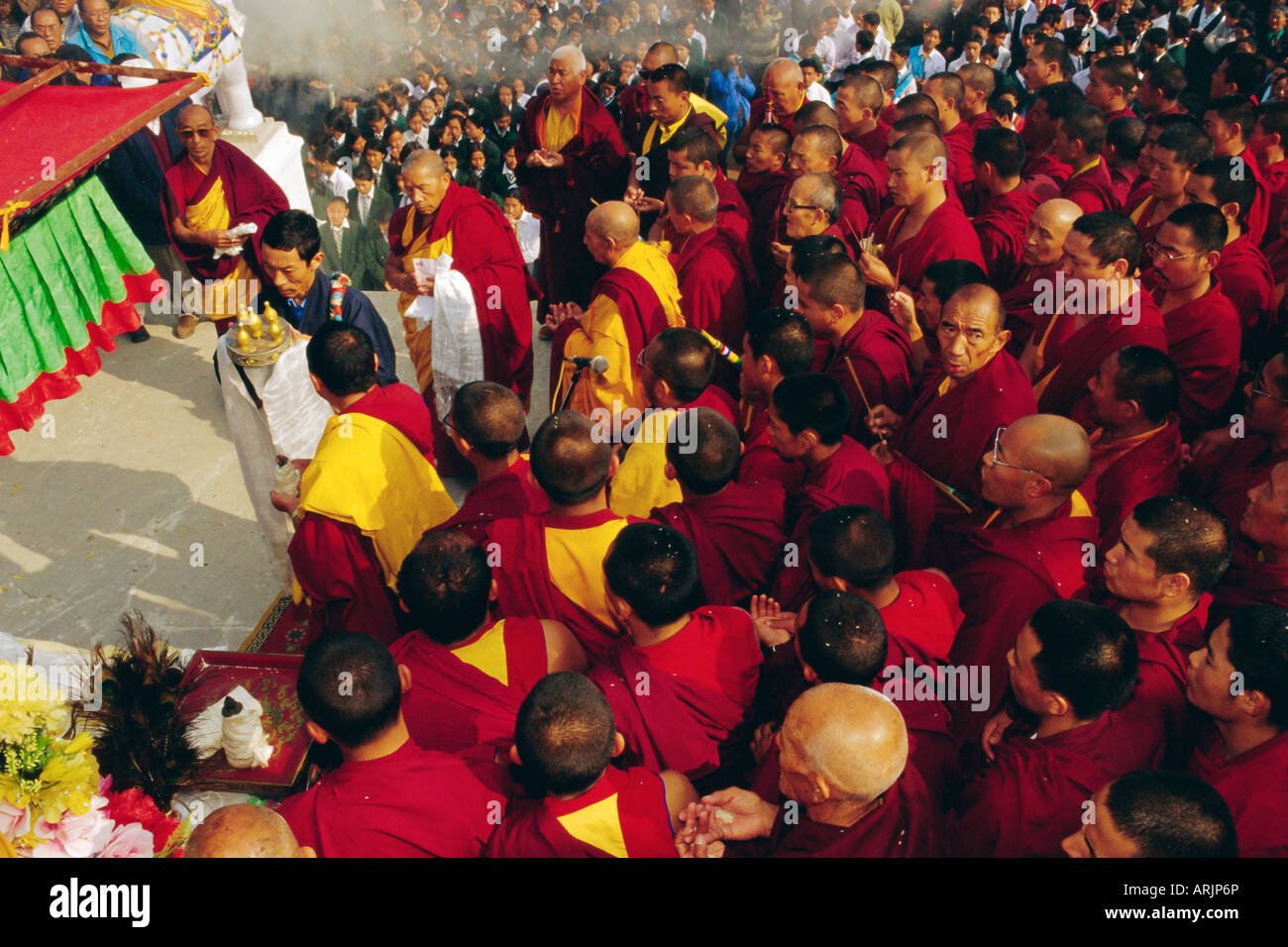 Buddhist monks giving offerings to the image of the Dalai Lama during the Losar (Tibetan New Year), Bodnath, Katmandu, - Stock Image