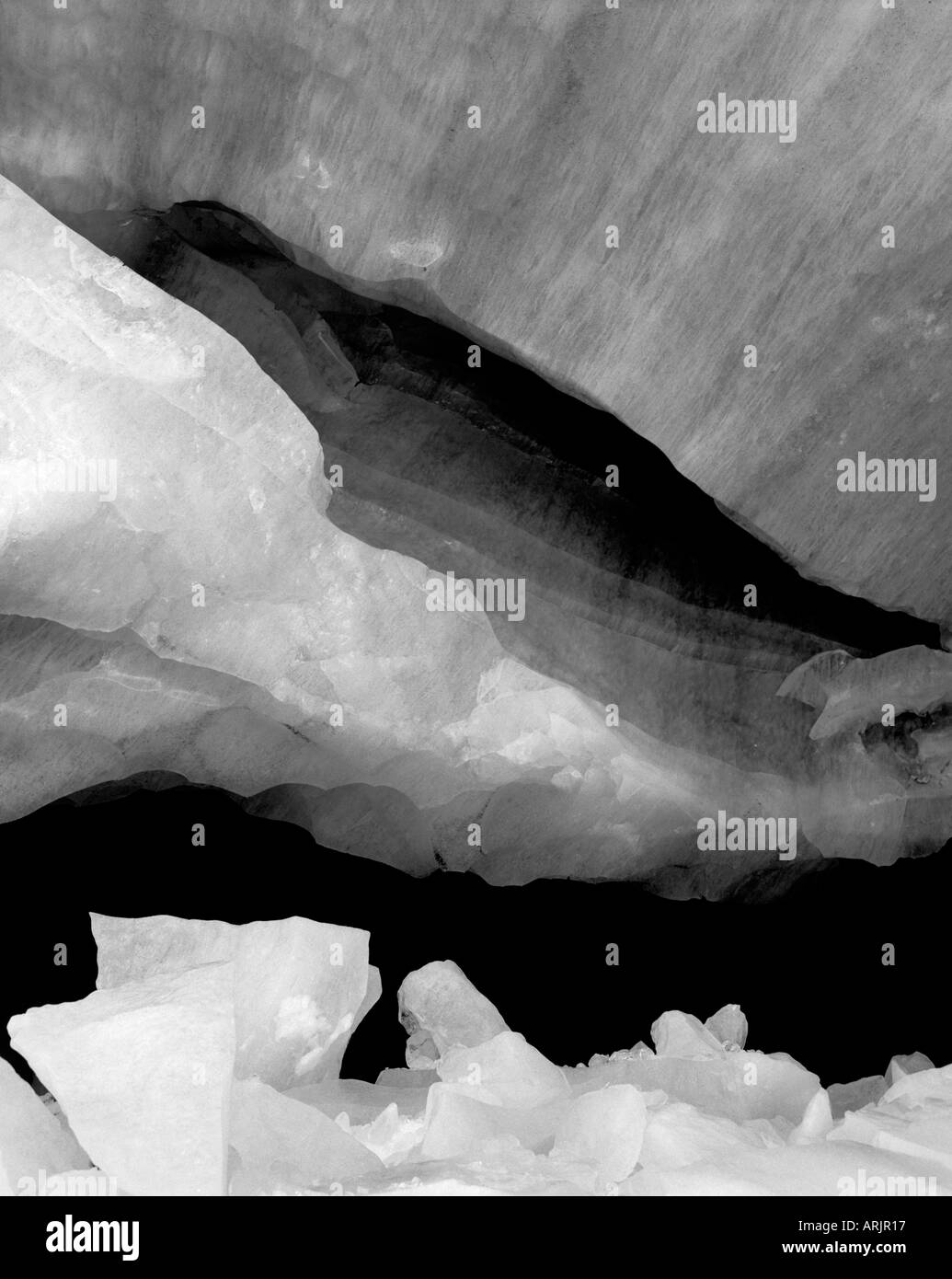 Closeup of glacier ice at the entrance of a naturally formed glacier cave Stock Photo