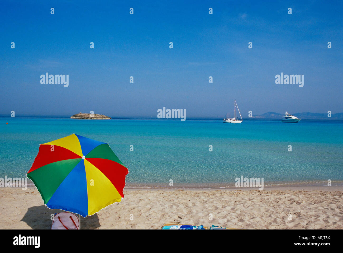 Colourful umbrella on Playa de ses Illetes beach, Formentera, Balearic Islands, Spain, Mediterranean, Europe - Stock Image