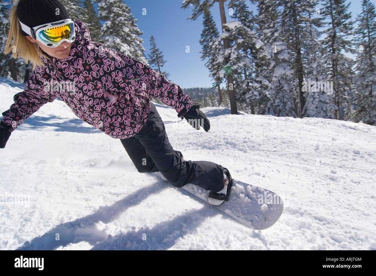 Woman snowboarding, Lake Tahoe, California, USA Stock Photo