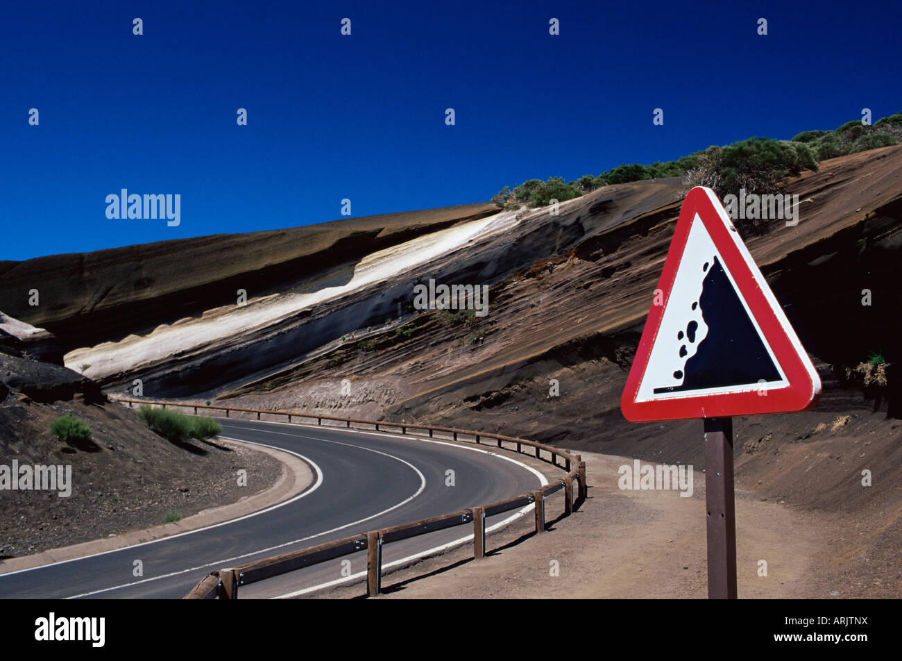 Sign on road with stratified volcanic rocks in the background, Parque Nacional del Teide, Tenerife, Canary Islands, - Stock Image