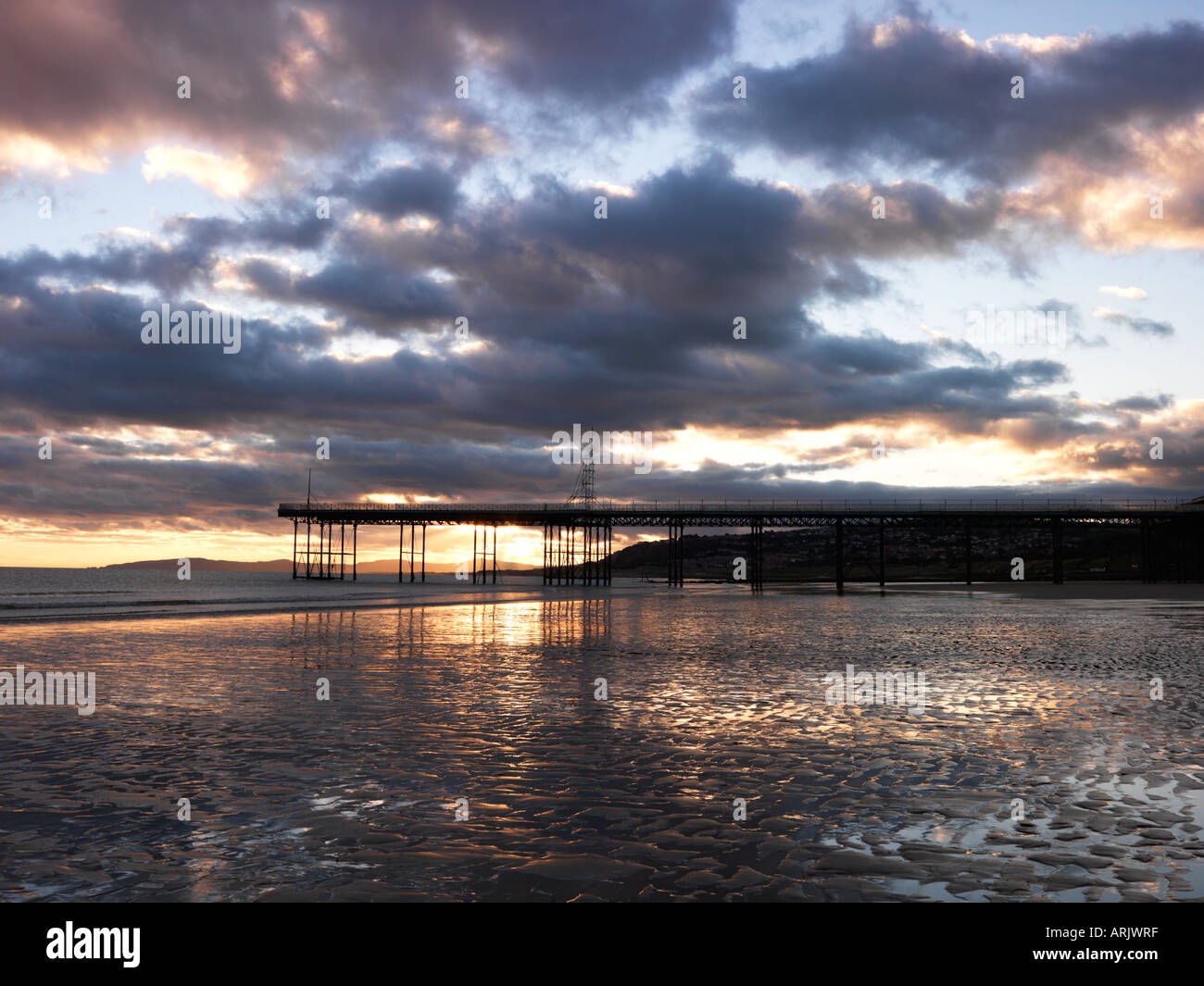 Dramatic Skies at Sunrise at Rhos-on-Sea Beach and Pier, Wales, Summer 2006 - Stock Image