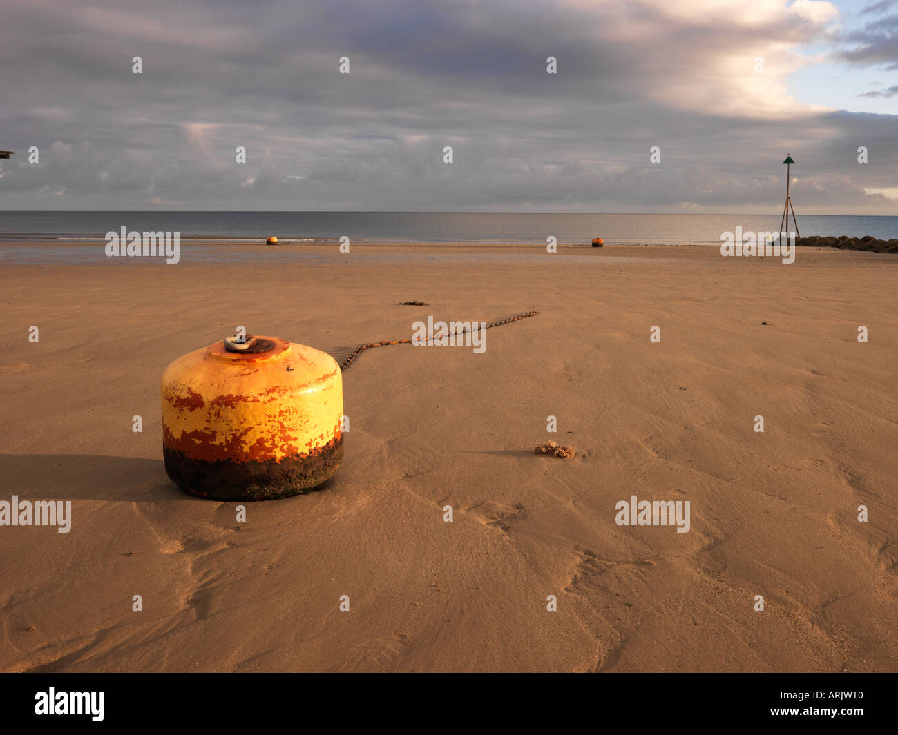 Buoy and chain on beach, Rhos-on-Sea, Wales, Summer 2006 - Stock Image