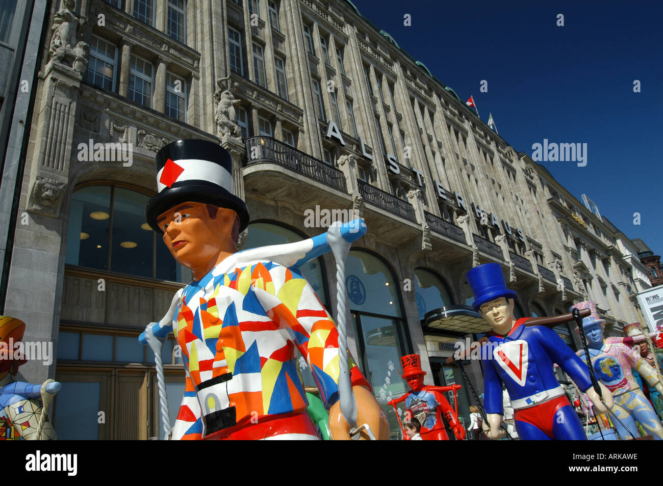 Attraction for tourists: the colorful symbols of Hamburg - the 'Hans Hummel' statues, concentrated on Jungfernstieg. Hamburg, Ge - Stock Image