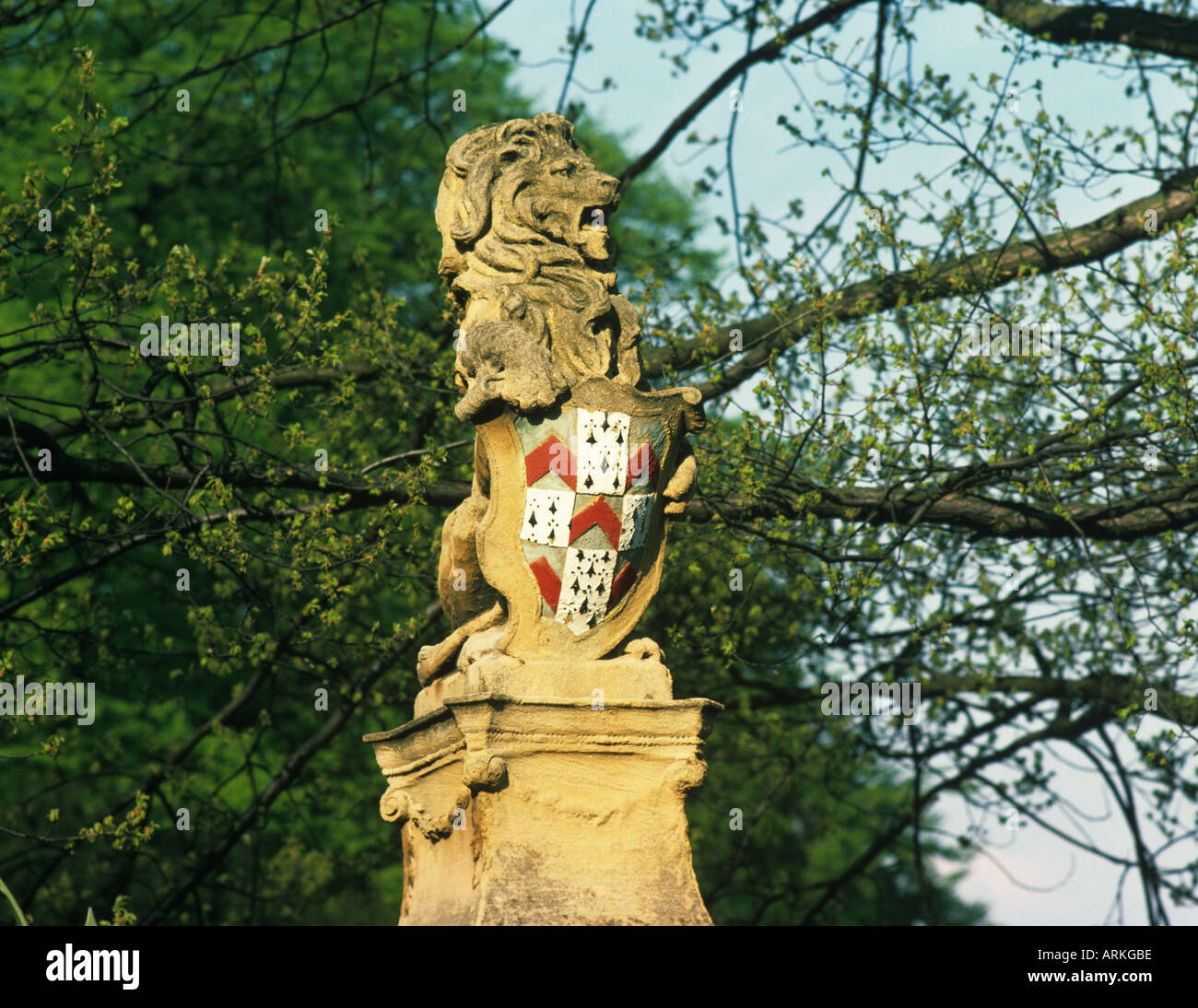 Statue of Lion holding a shield with the heraldry of The City of Lichfield Staffordshire Coat of Arms - Stock Image