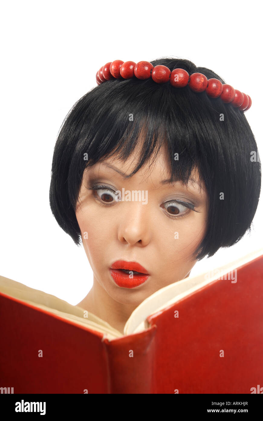 Emotional photo of the pretty model reading the red book - Stock Image