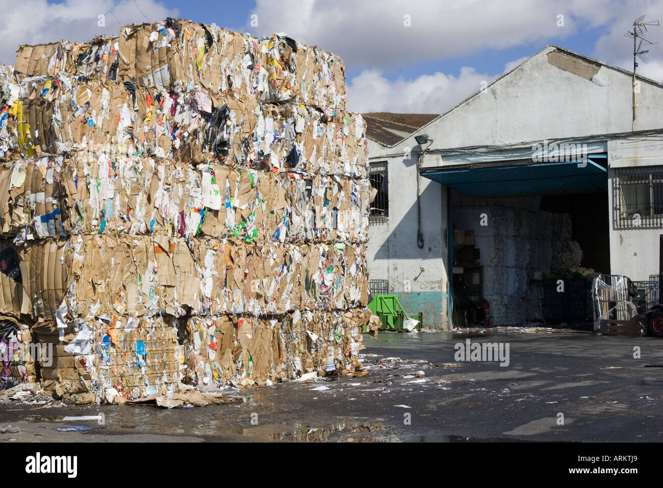 Bales of waste paper and cardboard cartons stacked awaiting