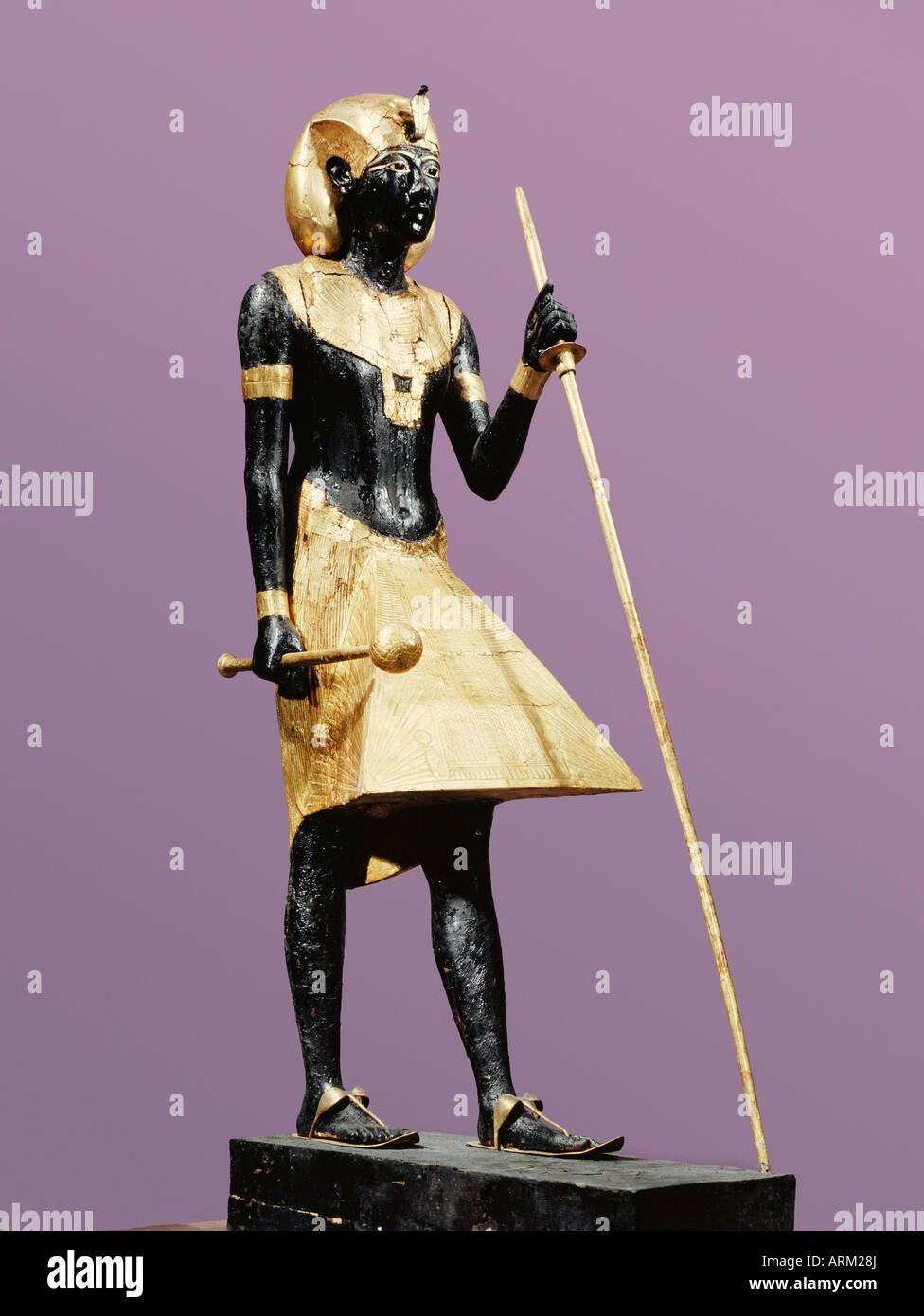 Life size statue of Tutankhamun made from black wood with applied gilded plaster, from the tomb of the pharaoh Tutankhamun - Stock Image
