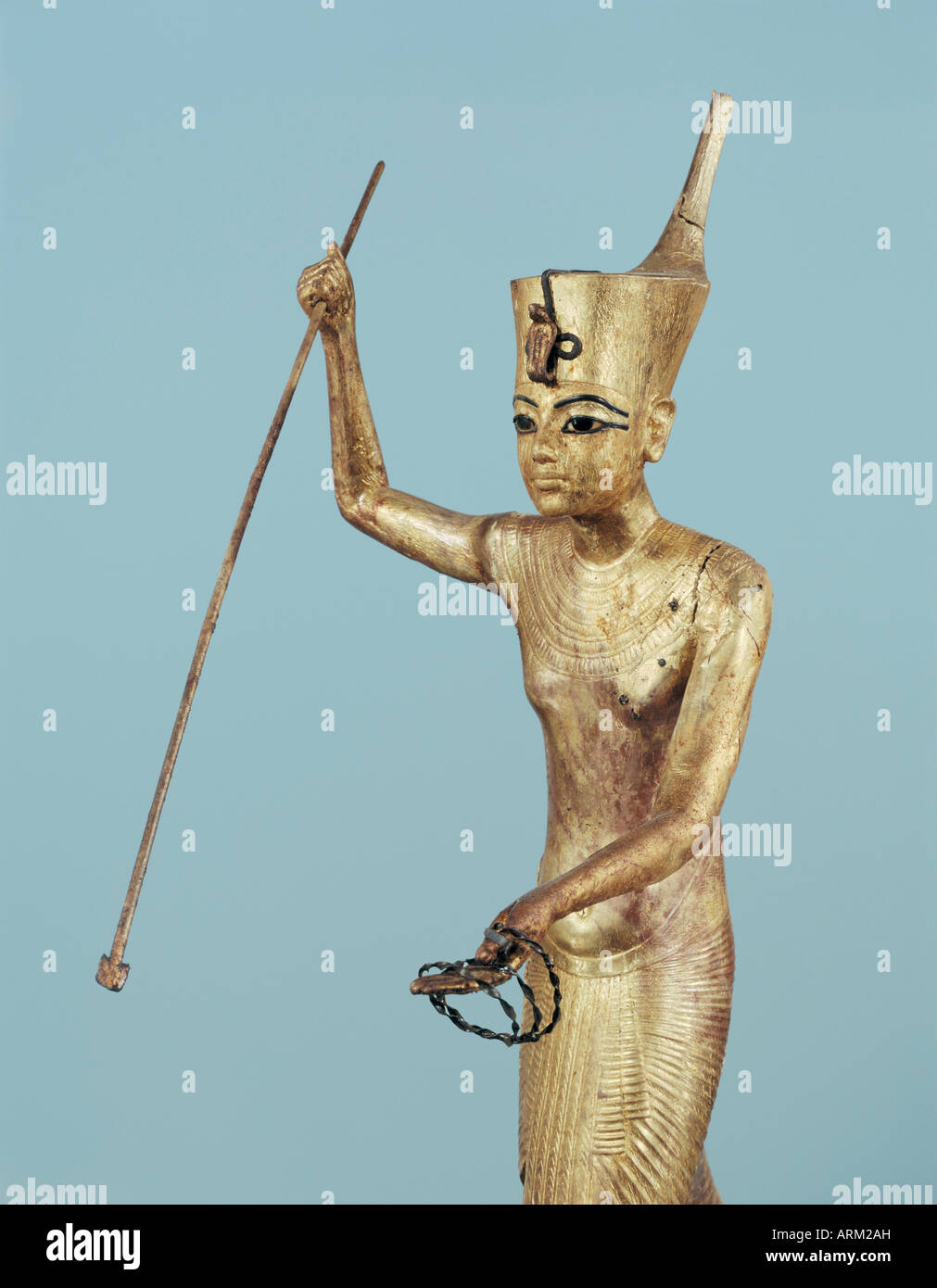 Gilt wood statuette of Tutankhamun on a boat with a harpoon, from the tomb of the pharaoh Tutankhamun - Stock Image