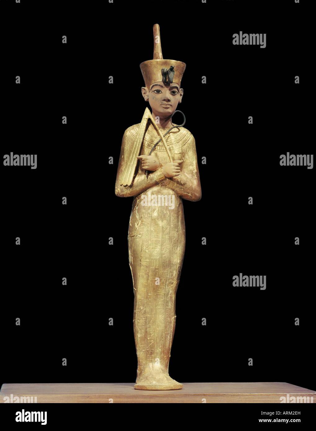 Ushabti of Tutankhamun, showning king wearing the red crown of the North, from the tomb of the pharaoh Tutankhamun - Stock Image