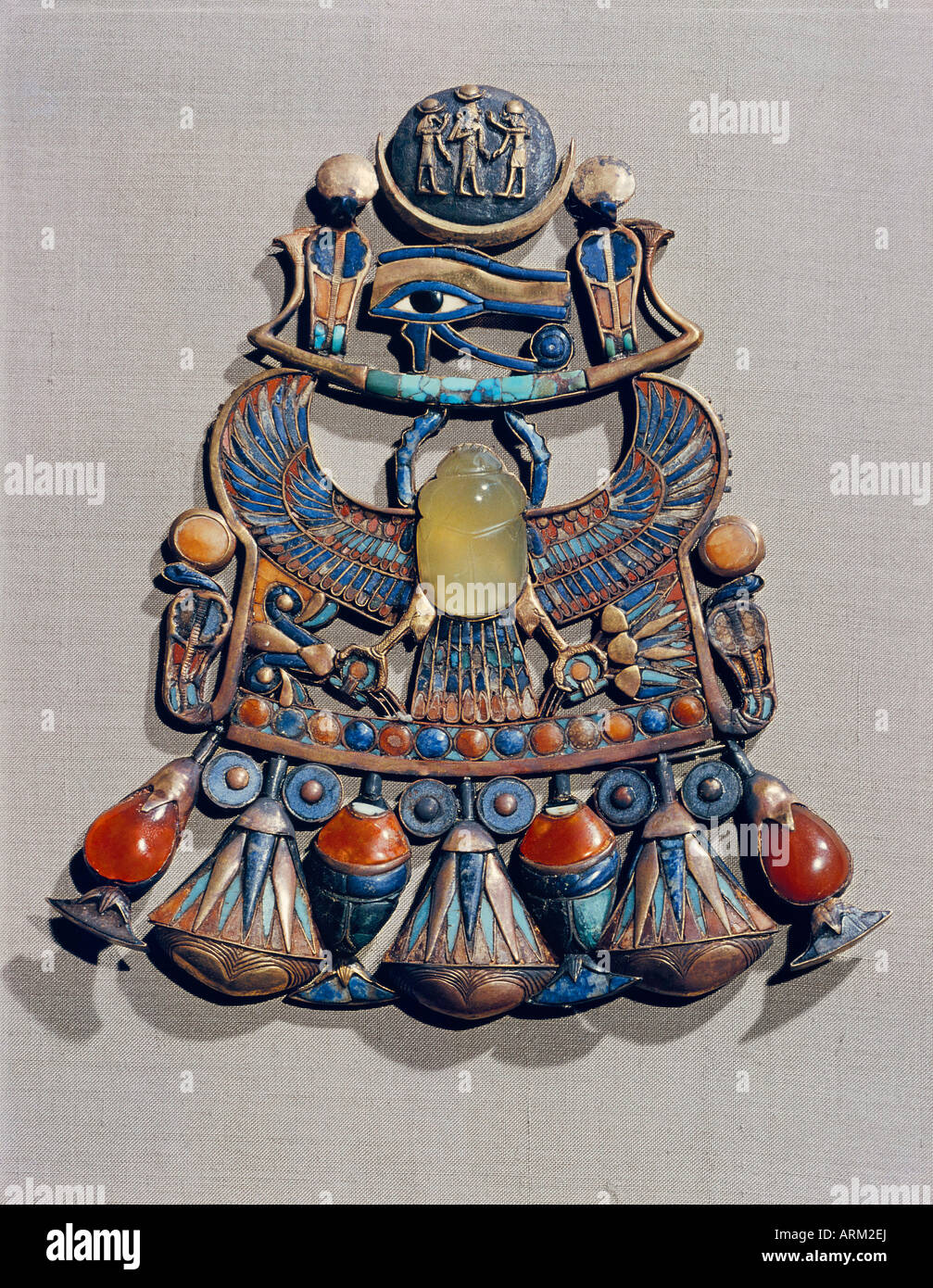 Pectoral in gold cloisonne with semi-precious stones, with winged scarab, symbol of resurrection, in centre - Stock Image