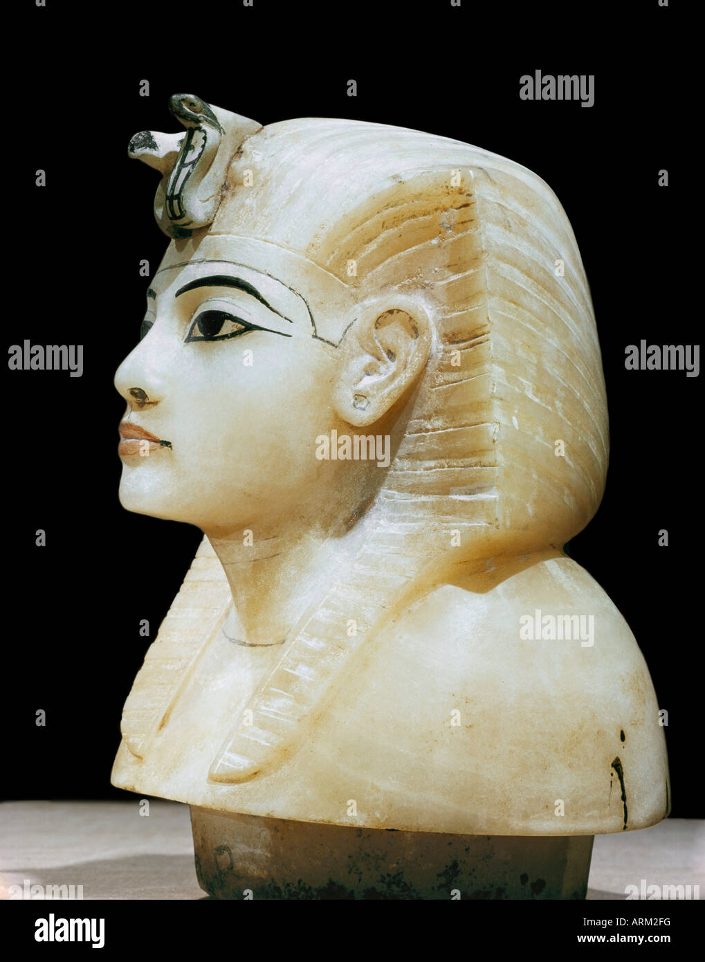 Stopper in the form of the king's head from one of the four canopic urns, from the tomb of the pharaoh Tutankhamun - Stock Image