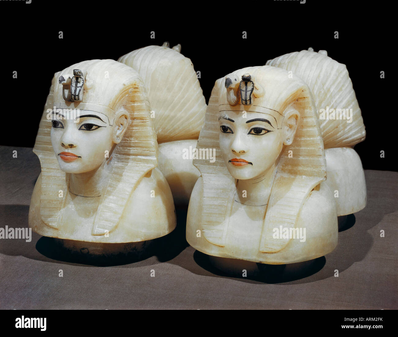 Stoppers in the form of the king's head from the four canopic urns, from the tomb of the pharaoh Tutankhamun - Stock Image