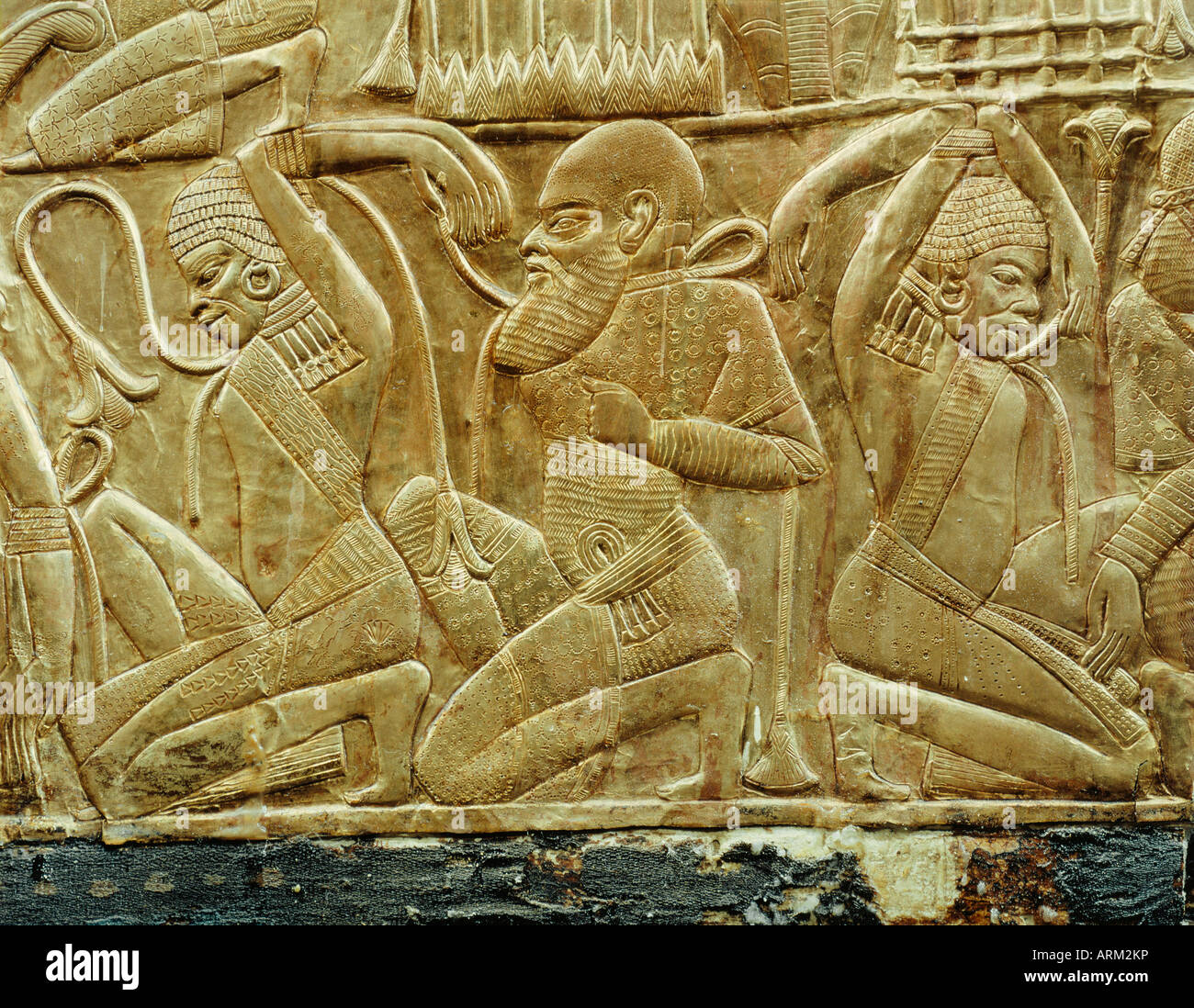 Detail from a state chariot showing the vanquished and enslaved enemies of Egypt, from the tomb of the pharaoh Tutankhamun - Stock Image
