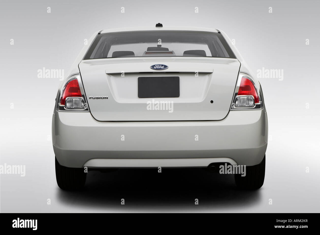 2008 Ford Fusion S in White - Low/Wide Rear - Stock Image