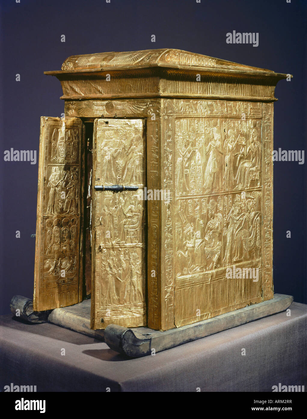The gilt shrine which originally contained the statuettes of the royal couple in the tomb of the pharaoh Tutankhamun - Stock Image