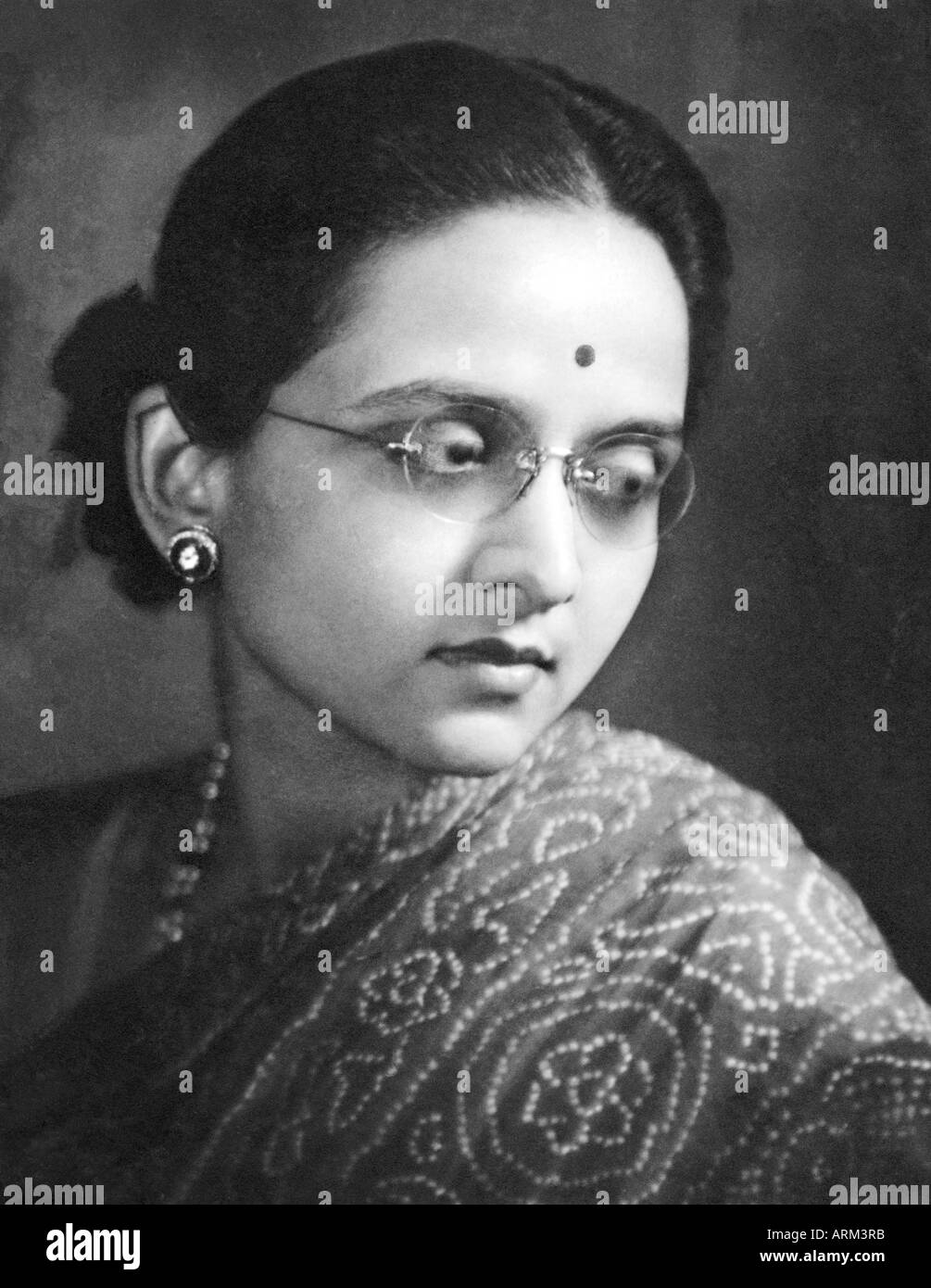 Vrb101305 Indian Woman With Specs And Bindi In Saree Portrait In