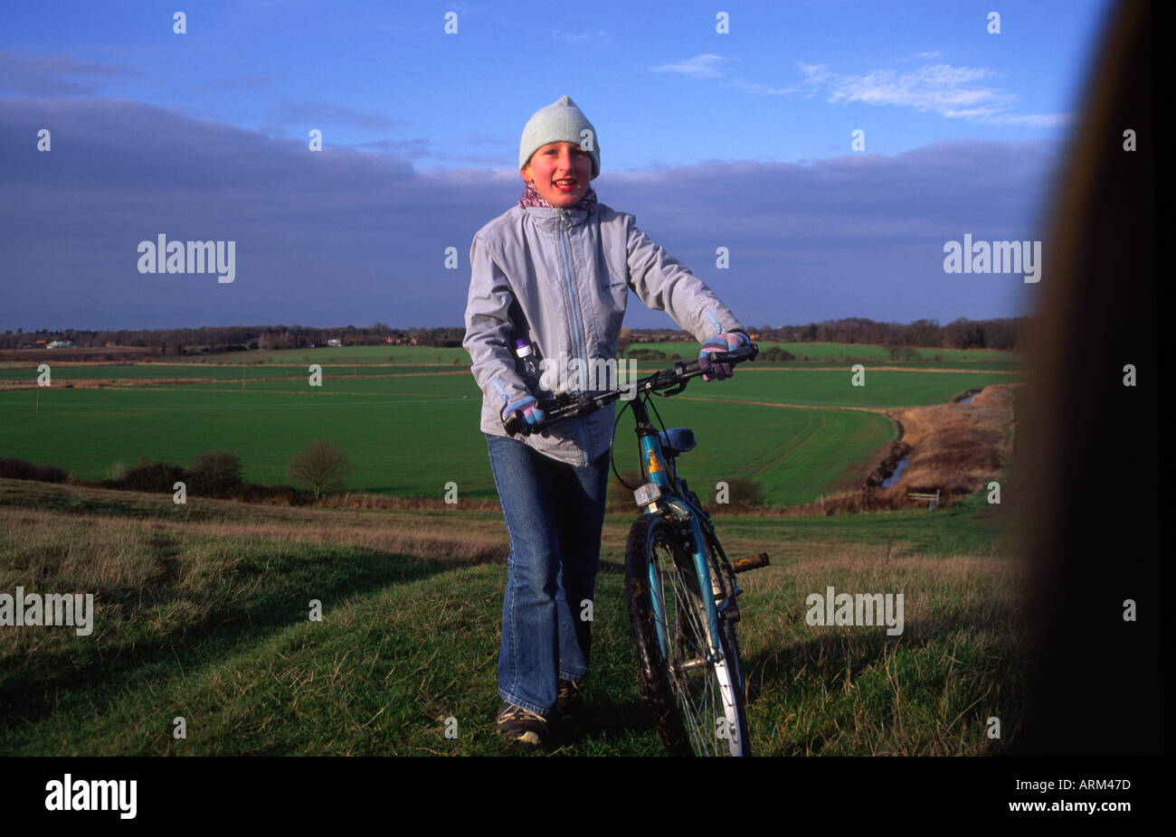 Child on country bike ride Burrow Hill Butley Suffolk England - Stock Image