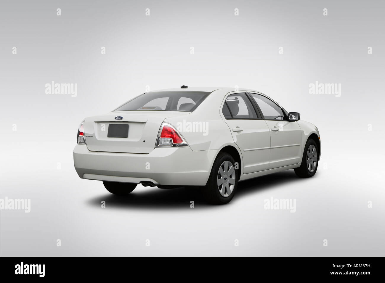 2008 Ford Fusion S in White - Rear angle view - Stock Image