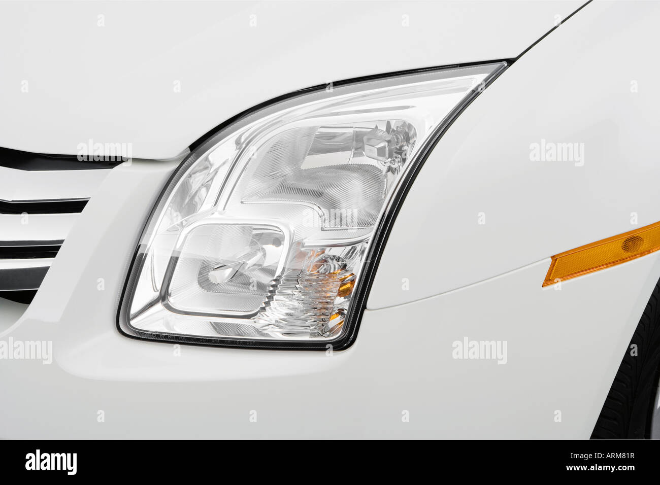 2008 Ford Fusion S in White - Headlight Stock Photo