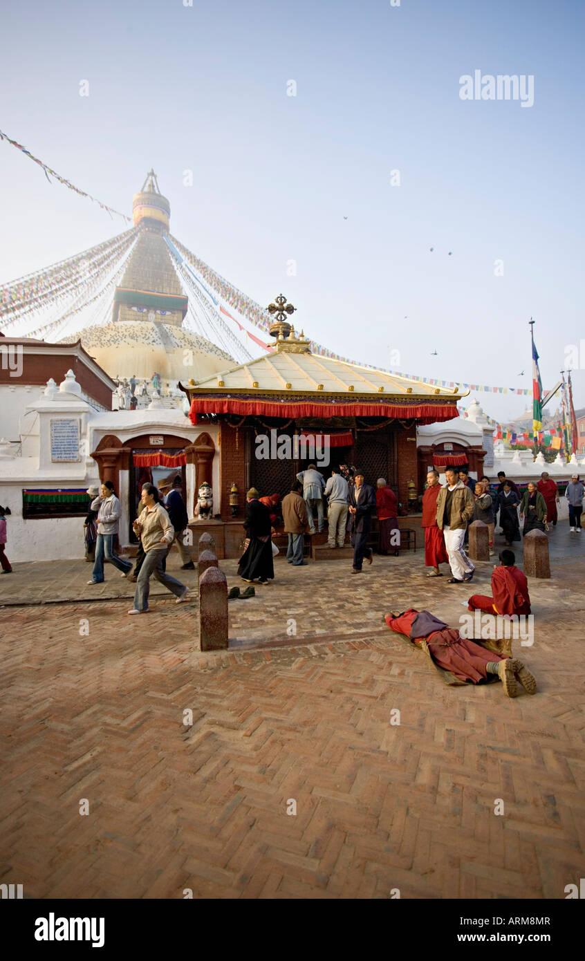 A Buddhist at dawn before the main entrance to Kathmandu's Tibetan stupa called Boudha (Boudhanath) (Bodhnath), - Stock Image
