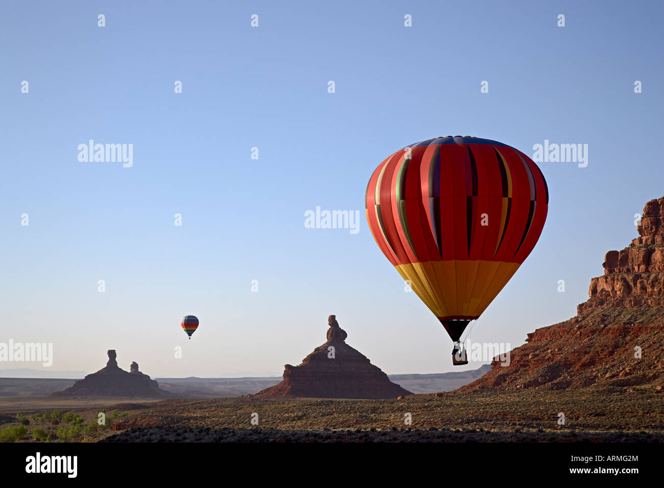 Formations in Valley of the Gods with two hot air balloons, near Mexican Hat, Utah, United States of America, North - Stock Image