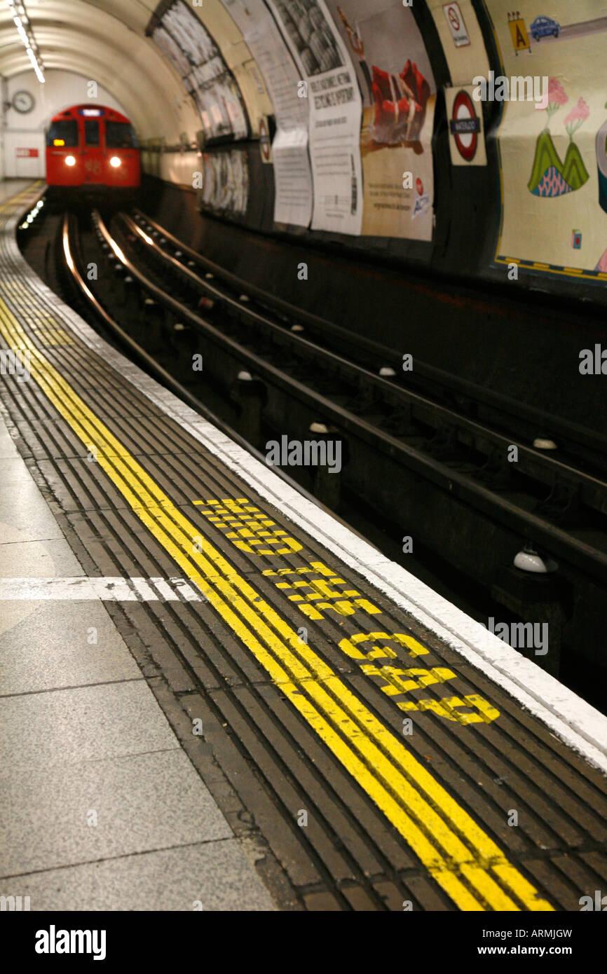Mind The Gap written on the Bakerloo Line platform at Waterloo Tube Station, London - Stock Image