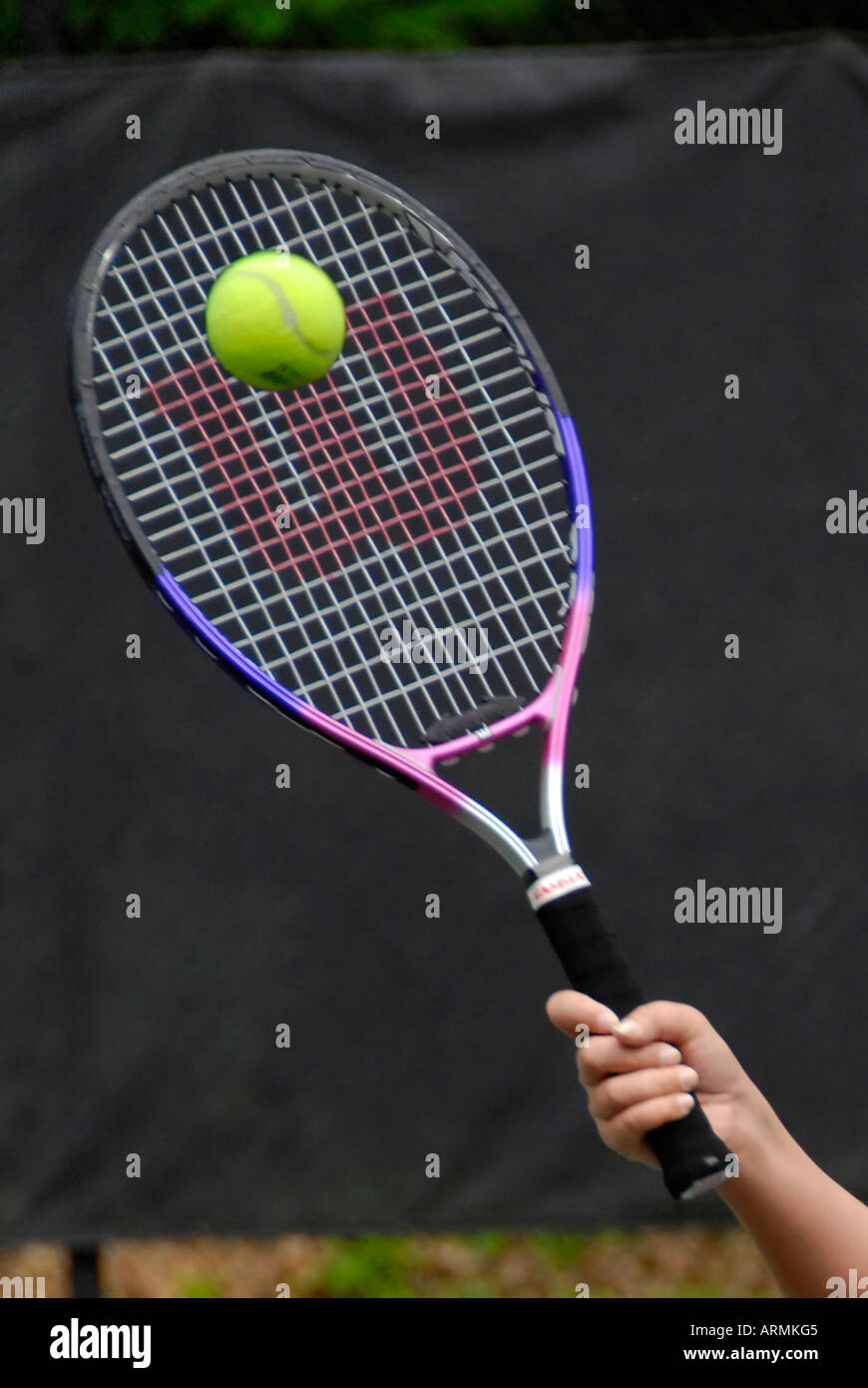 Middle school and high school age teenagers take Tennis lesson in a summer enrichment and development public city program - Stock Image