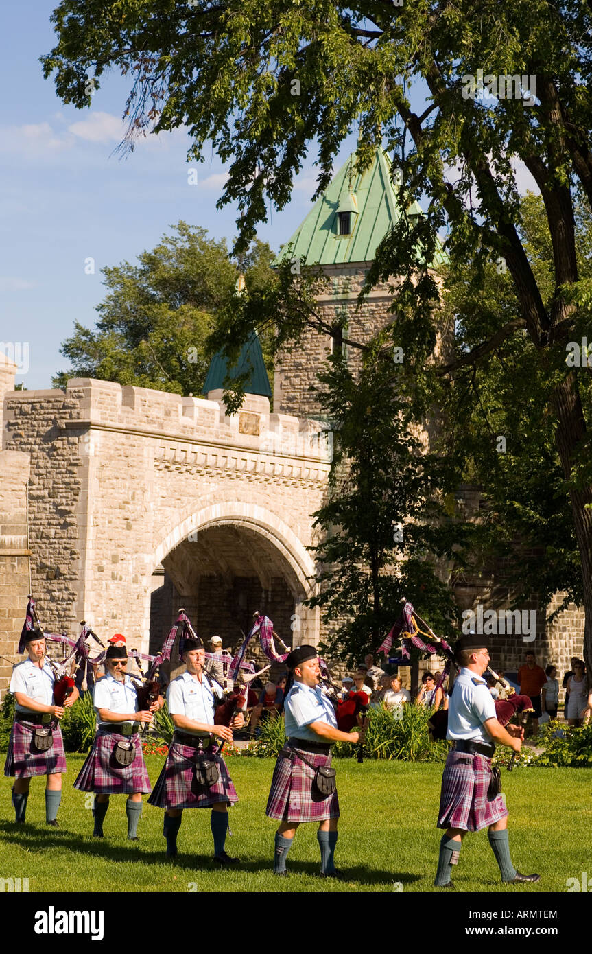 Military pipe and drum band at tatoo, Porte St. Louis, one of the entrances of the walled city of old Quebec, Quebec, Stock Photo