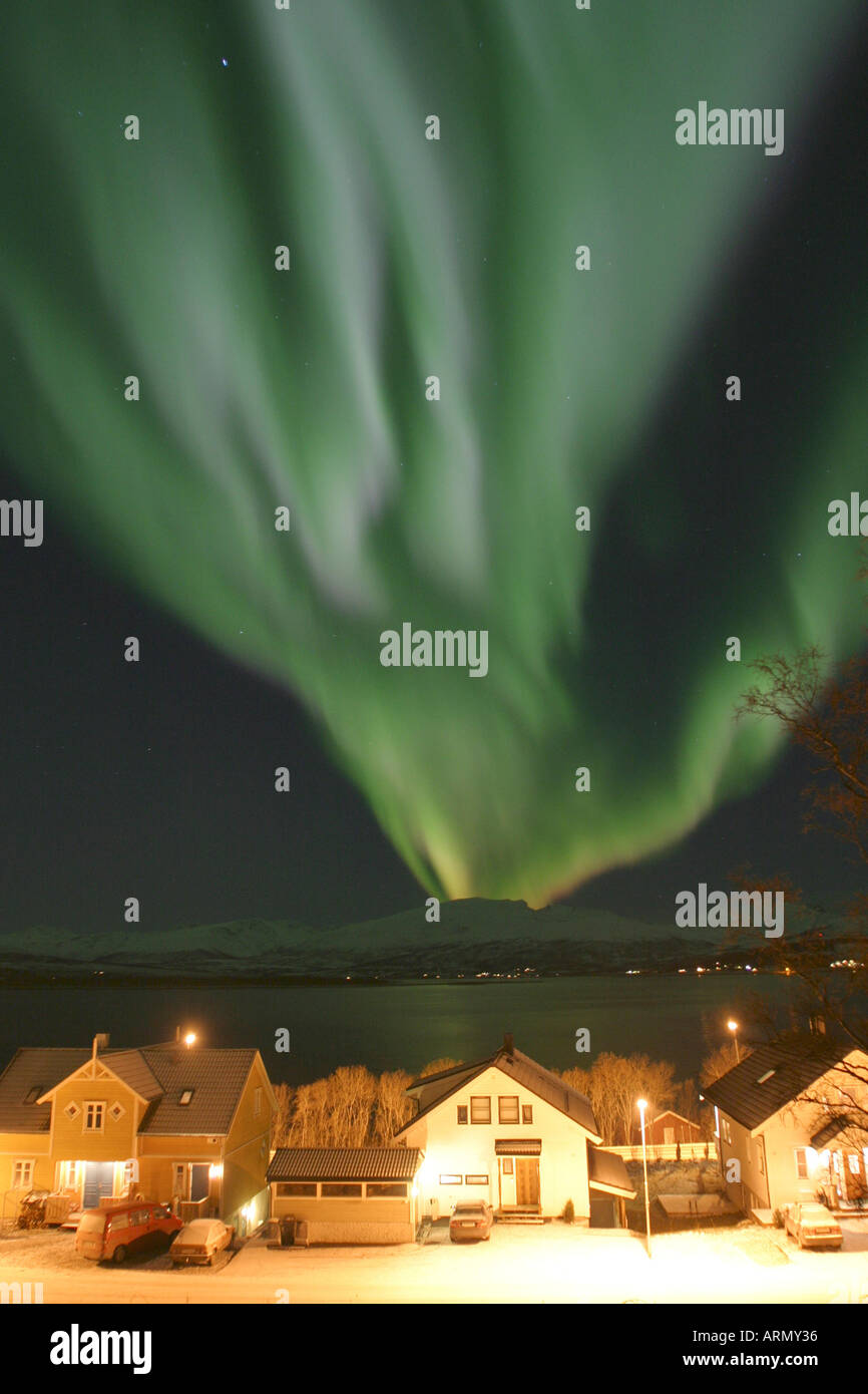 northern lights over houses in Troms, Norway, Troms, Tromsoe, Nov 03. Stock Photo