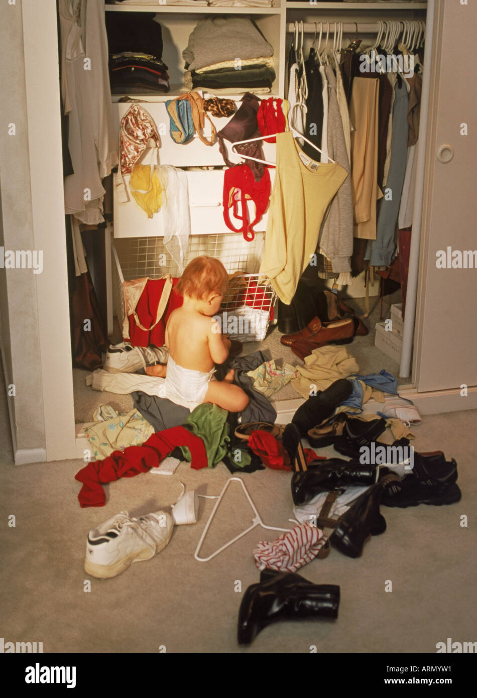 Baby Argues About Trying On Bedroom Shoes: Chaotic Closet Stock Photos & Chaotic Closet Stock Images