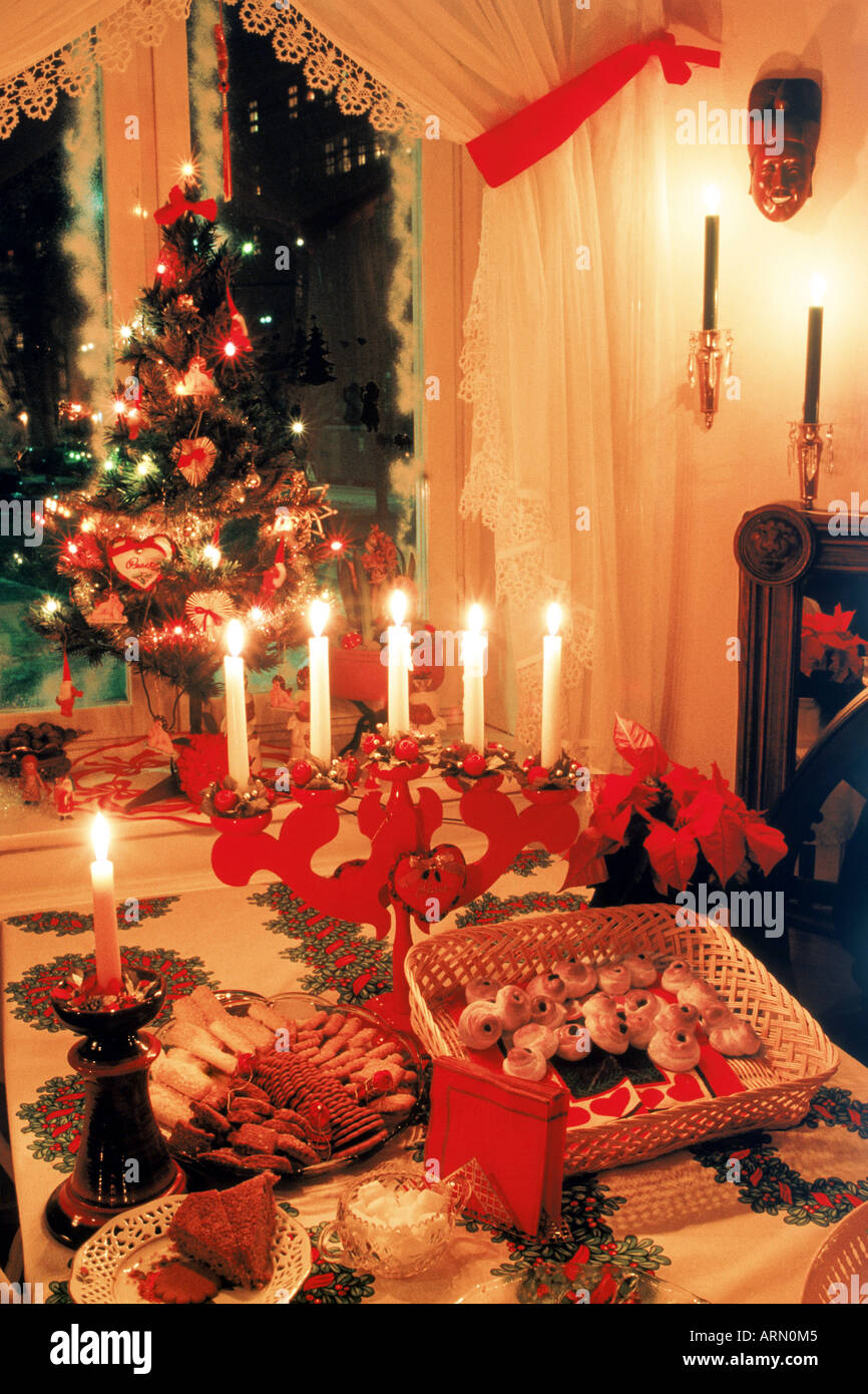 swedish christmas table or julbord with traditional food and candlelight stock image - Traditional Swedish Christmas Decorations