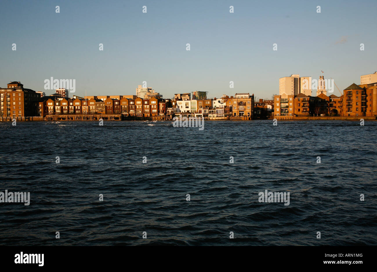 Looking across the River Thames to Limehouse, London - Stock Image