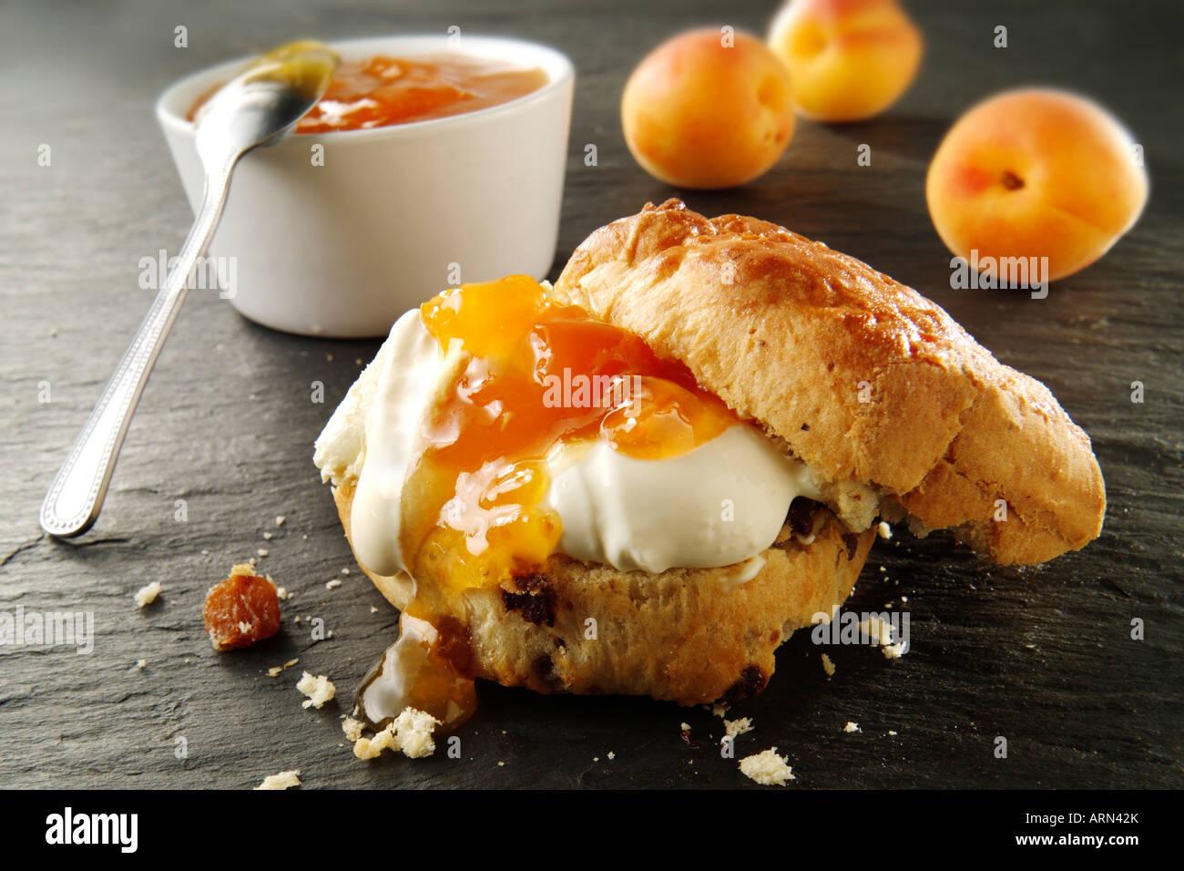 Traditional British sweet scones, cream and apricot jam - Stock Image