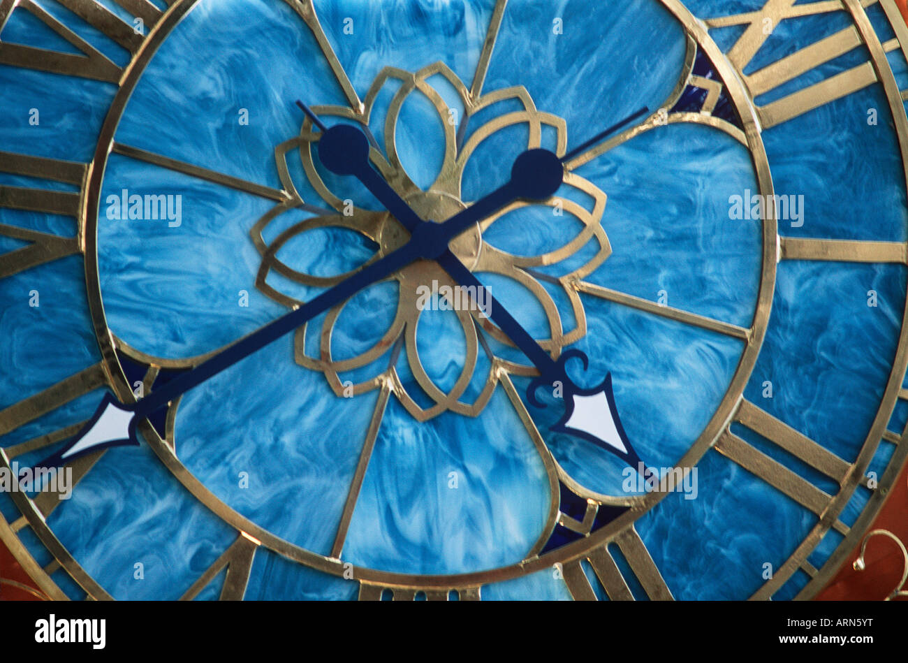 Time clock with roman numerals, British Columbia, Canada. - Stock Image