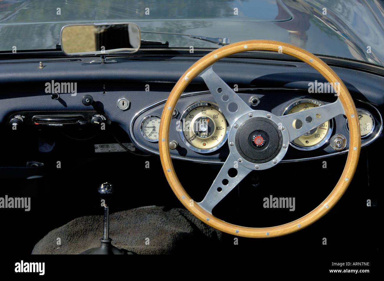 Wooden Steering Wheel Of Vintage British Car Austin Healey Stock
