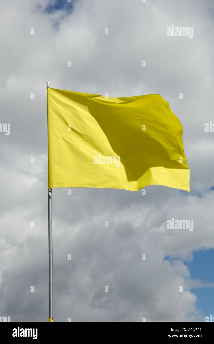 Yellow flag fluttering - Stock Image