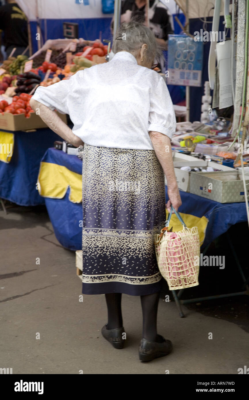 Old woman carrying basket shopping at local fruit and vegetable market Moscow Russia Eastern Europe - Stock Image