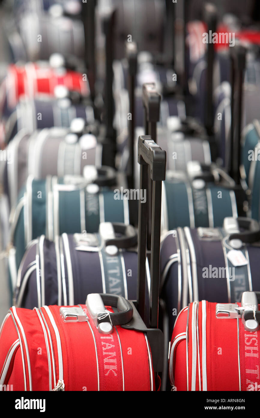 rows of wheeled luggage cases in a row outside a shop in puerto de la cruz tenerife canary islands spain - Stock Image