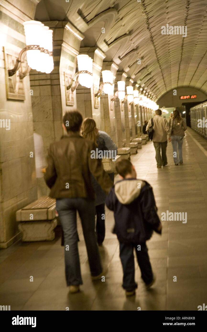 Man and boy walking down a platform in the Metro Moscow Russia Eastern Europe July 2006 - Stock Image
