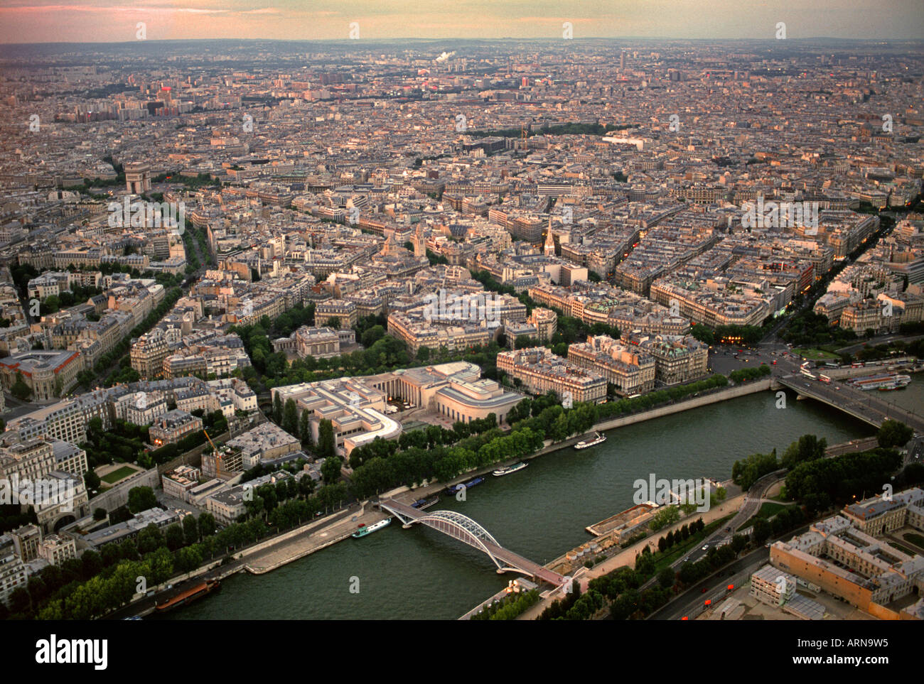 Sunset view of Paris from the Eiffel Tower across to Port Debilly Pont de L alma and 'Avenue New York' - Stock Image